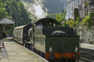 A steam engine at the station on the Llangollen Railway