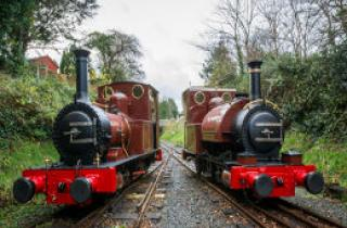 Two red steam engines on the Tallylyn Railway