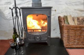 The cosy woodburner at Pentre Bach WAG214
