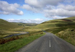 An empty road running through the Cambrian Mountains