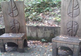 Carved wooden chairs in a Llandrindod Wells park