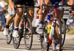 Close up of professional cyclists racing