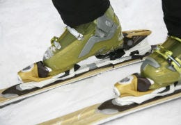 Close up photo of skis on snow