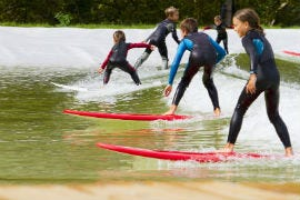 Surfing the man-made wave at Surf Snowdonia