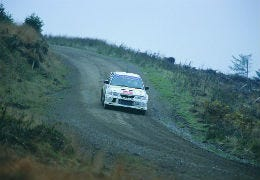Rally car driving a stage in Wales