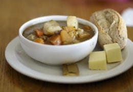 Welsh Cawl tasty lamb stew with a bread roll