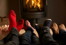Feet up in front of a cosy fire in your self-catering cottage