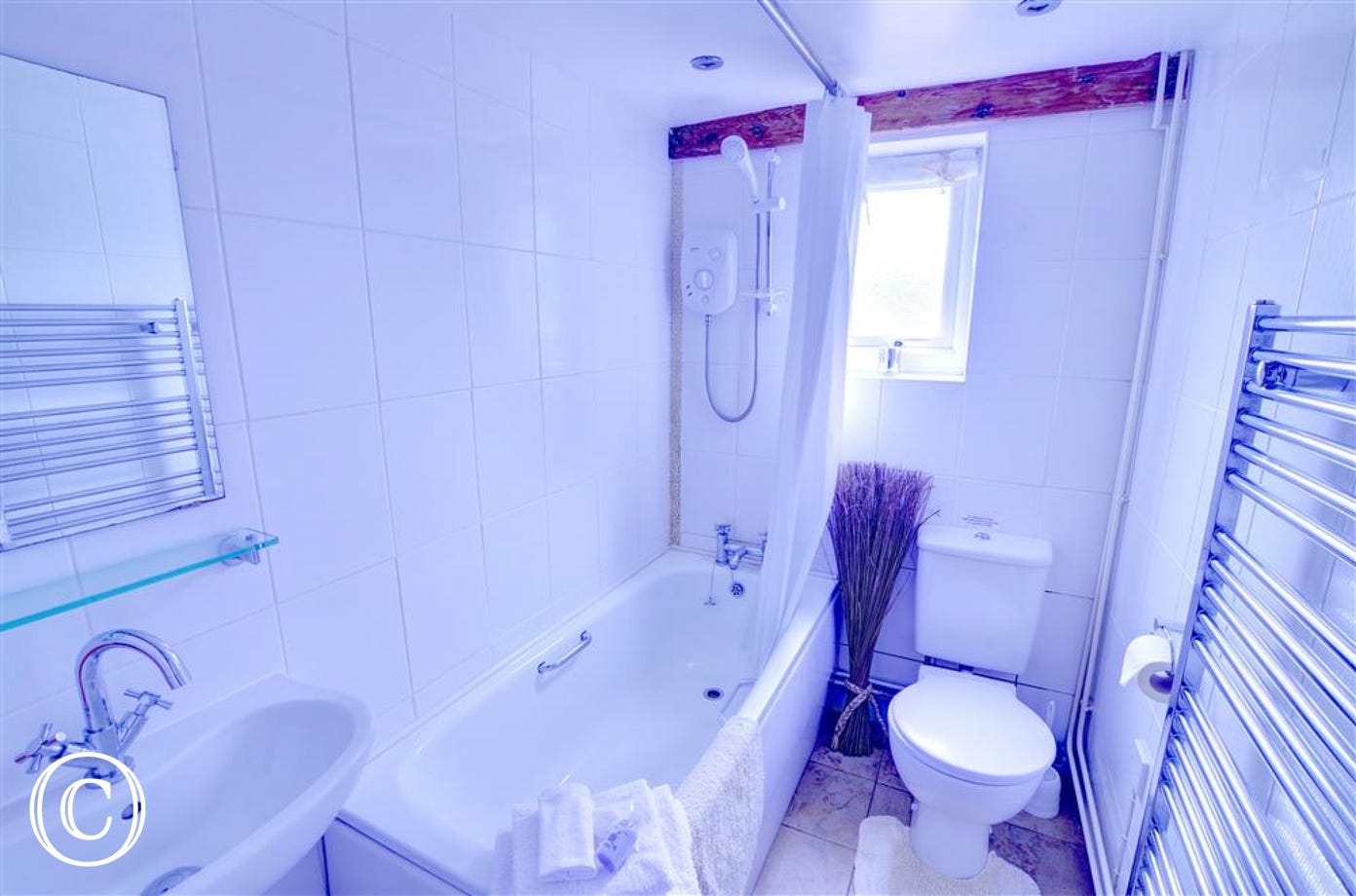 The bathroom has been refurbished with a clean white suite with modern fittings