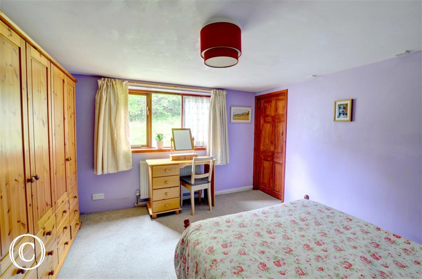 The good sized double bedroom has pine bedroom furniture with plenty of wardrobe space