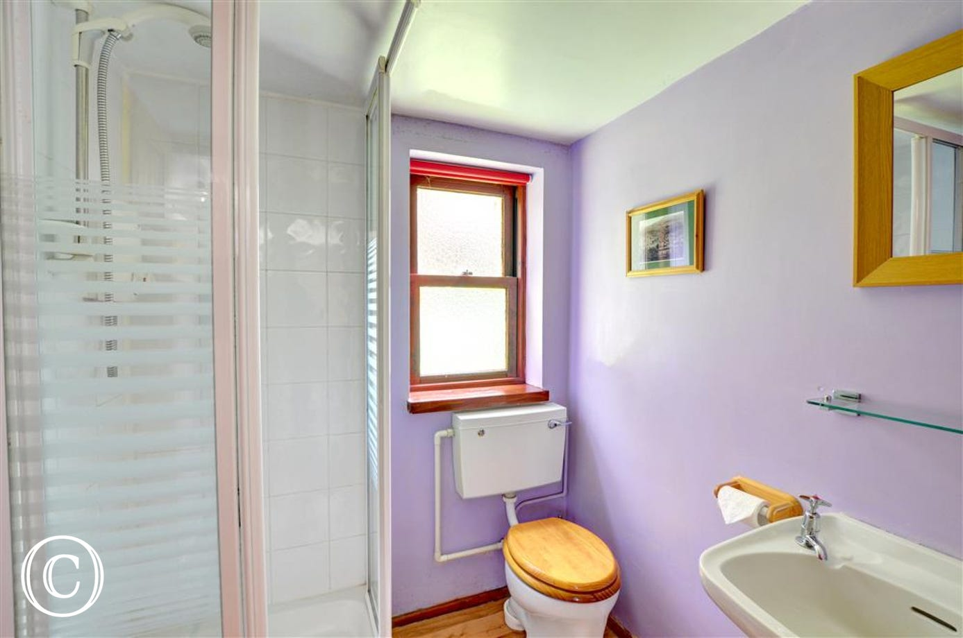 The shower room is decorated in the same colours as the double bedroom