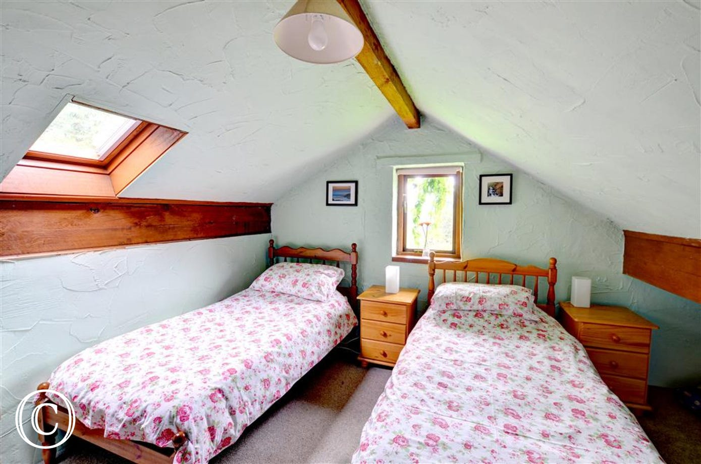 There are two similar twin bedrooms in the 'attic', with sloping ceilings