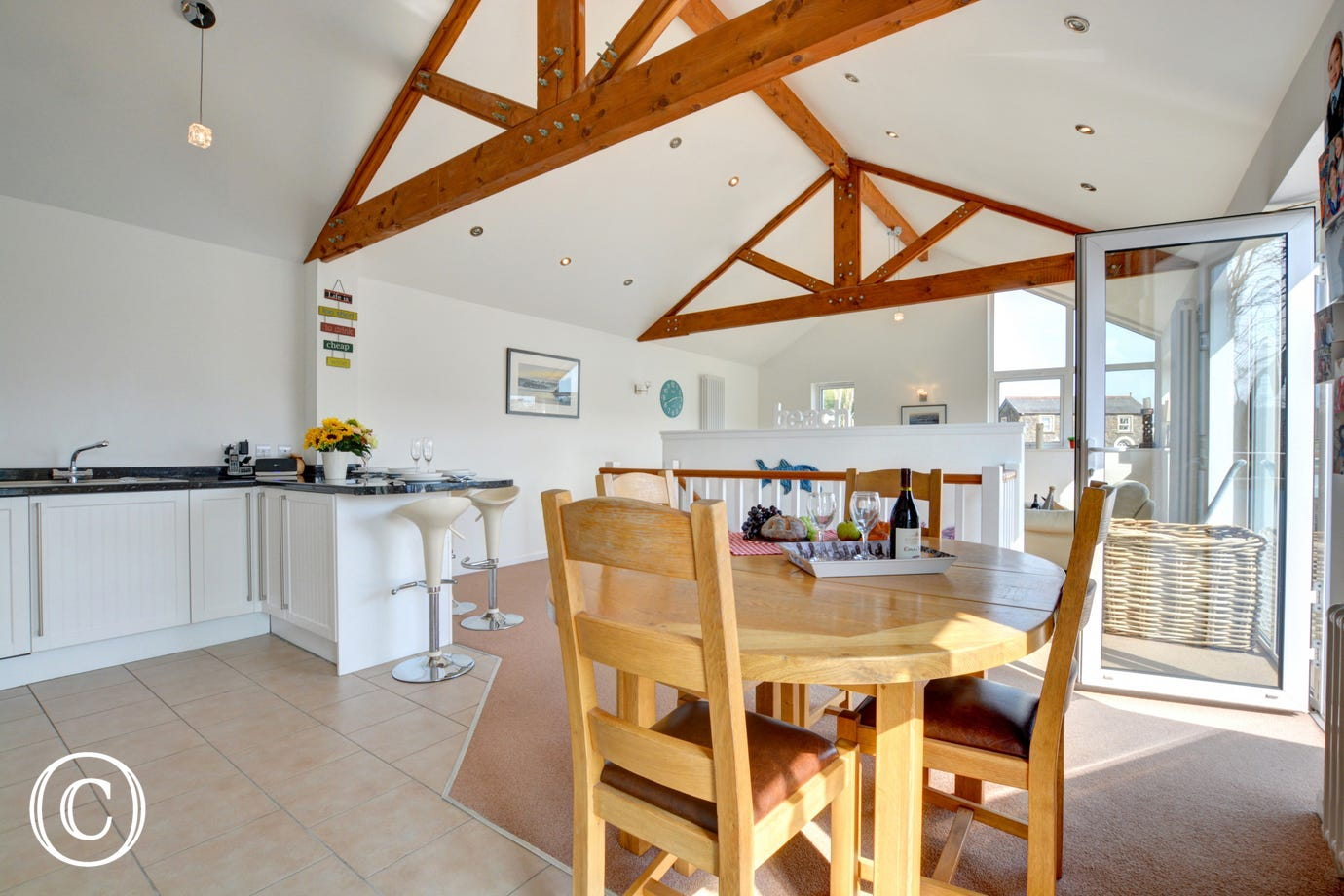 Dining table & chairs set within the dining area of this contemporary property