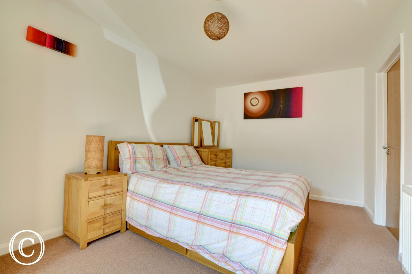 A spacious double bedroom with en-suite shower room