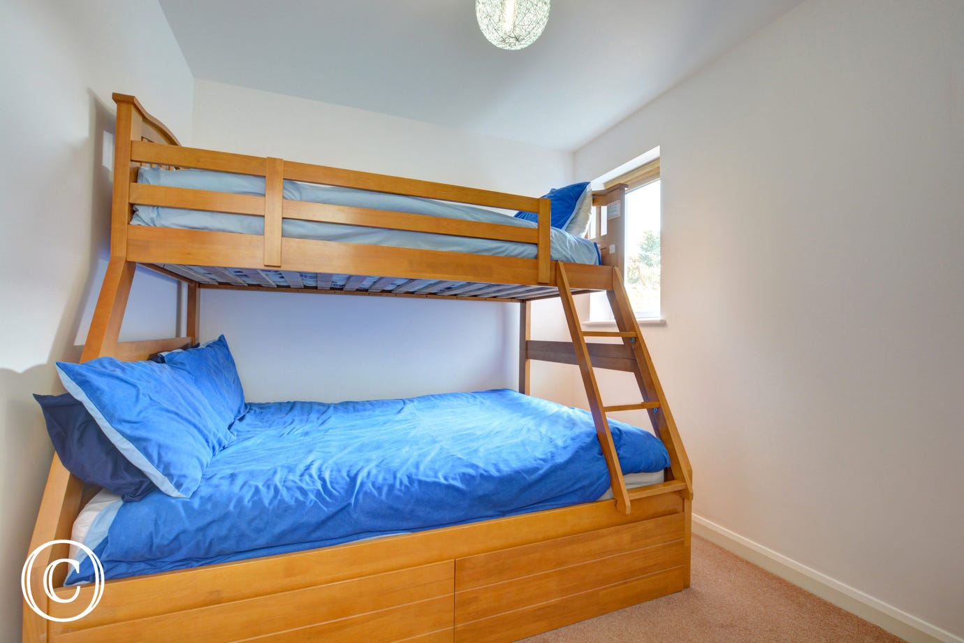 A double bed with single over.