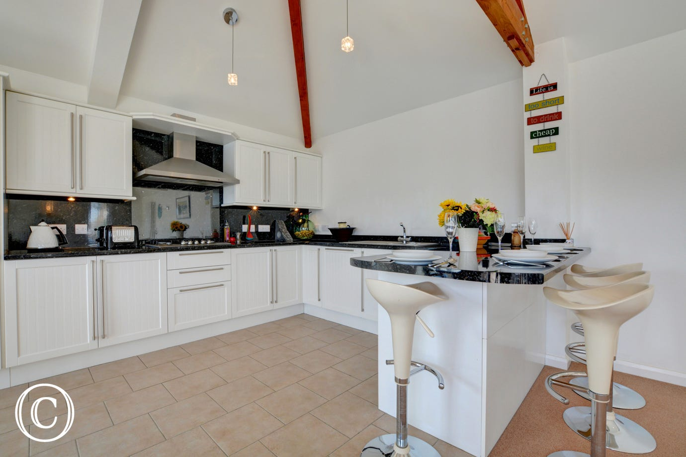 A modern kitchen area with character beams making this an ideal self catering property.