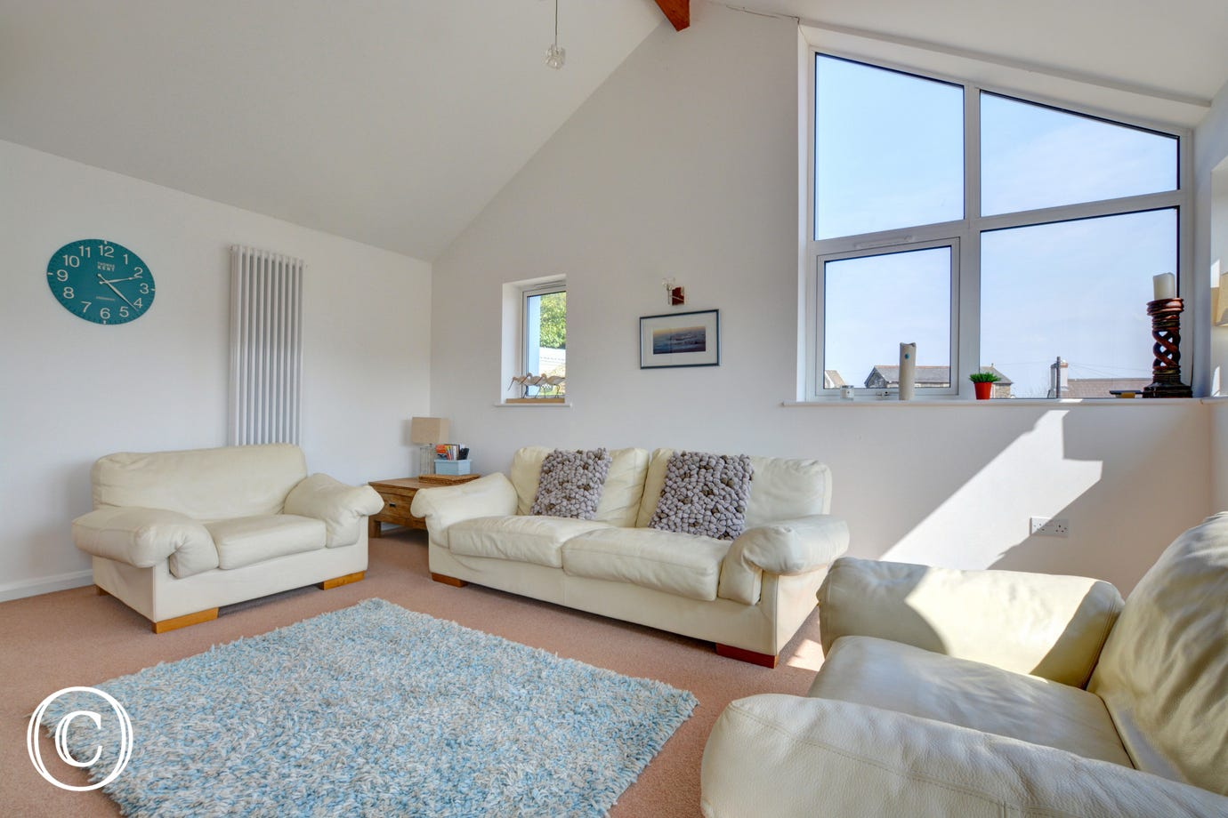 Large glass windows at Oyster Court make this holiday property creating a light & bright