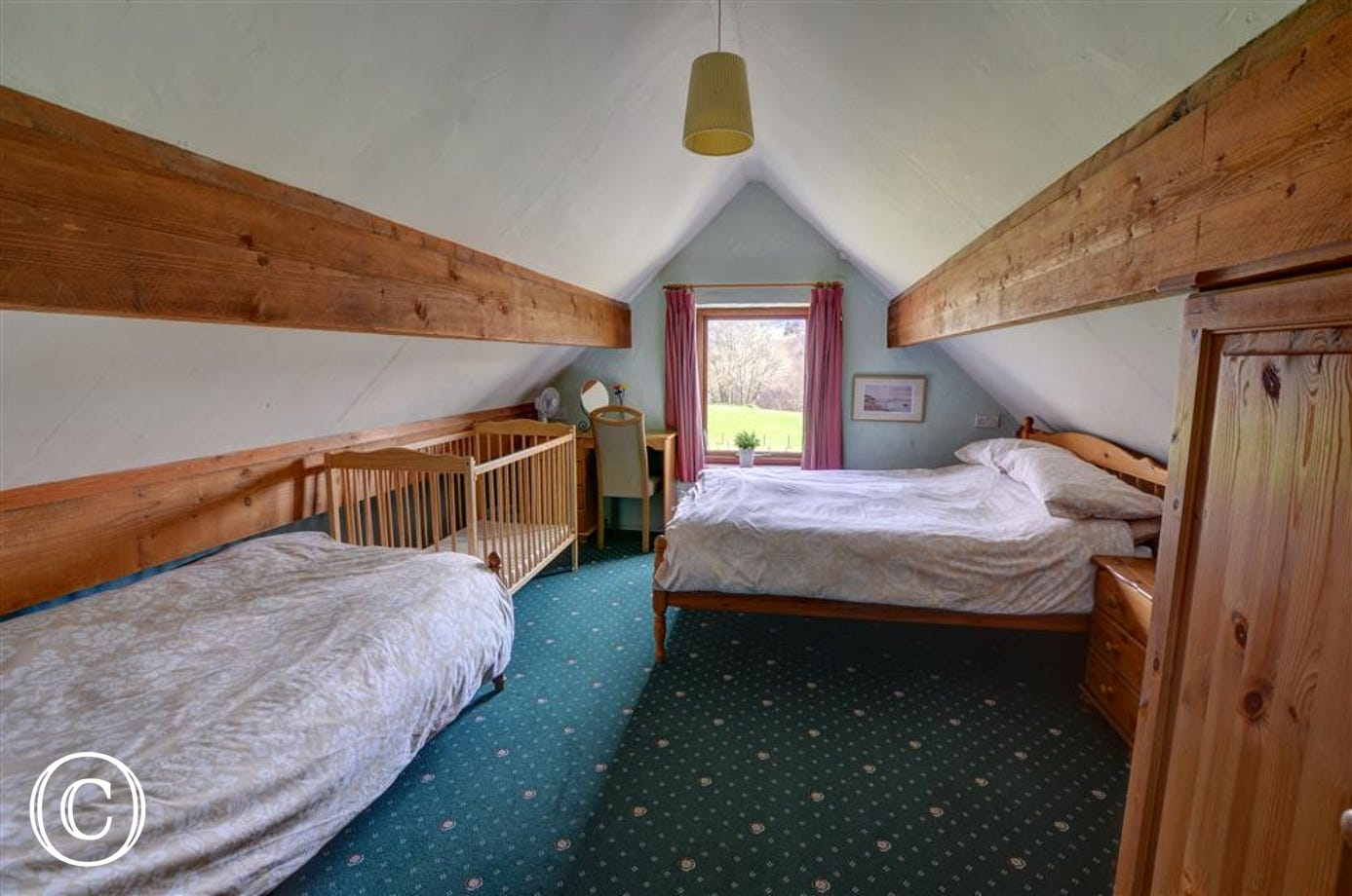 First floor family room includes double and single beds and a cot if required