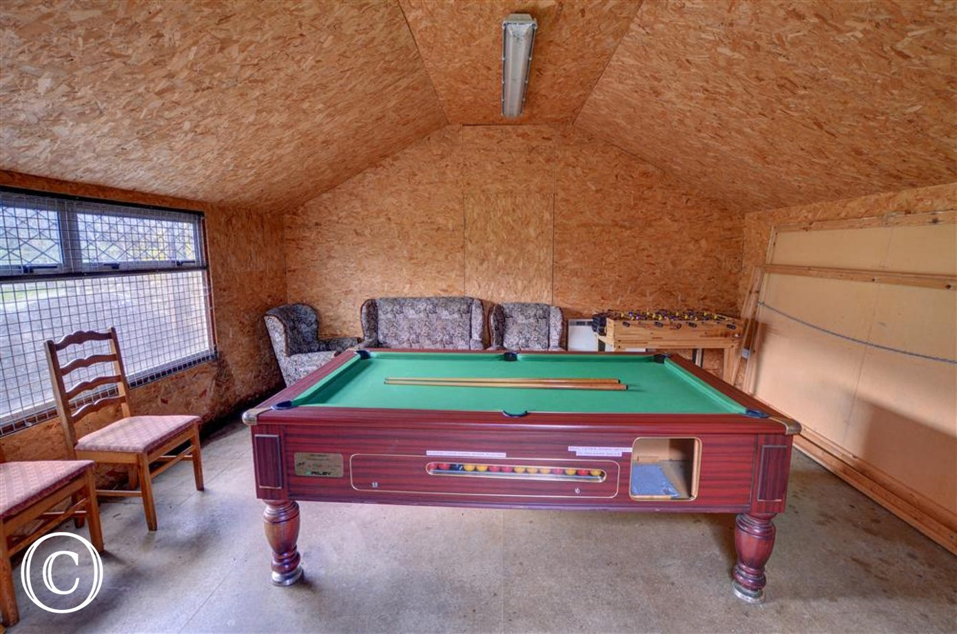 The games room with snooker table etc is in a detached building in Barn Cottage's garden