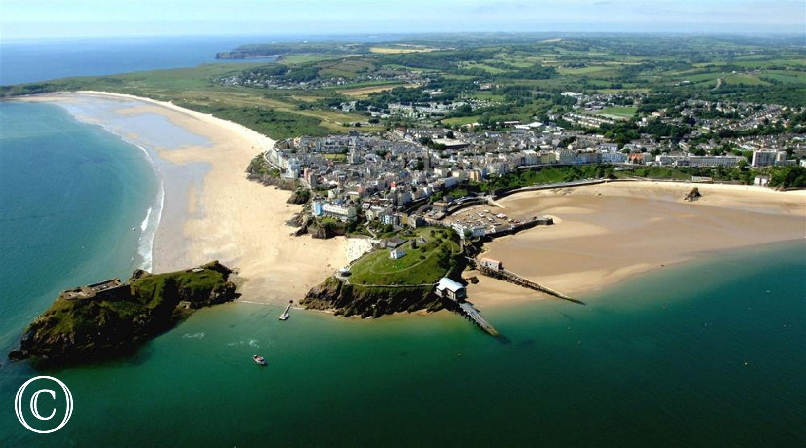 Tenby aerial shot of harbour and sandy beaches just a short drive away