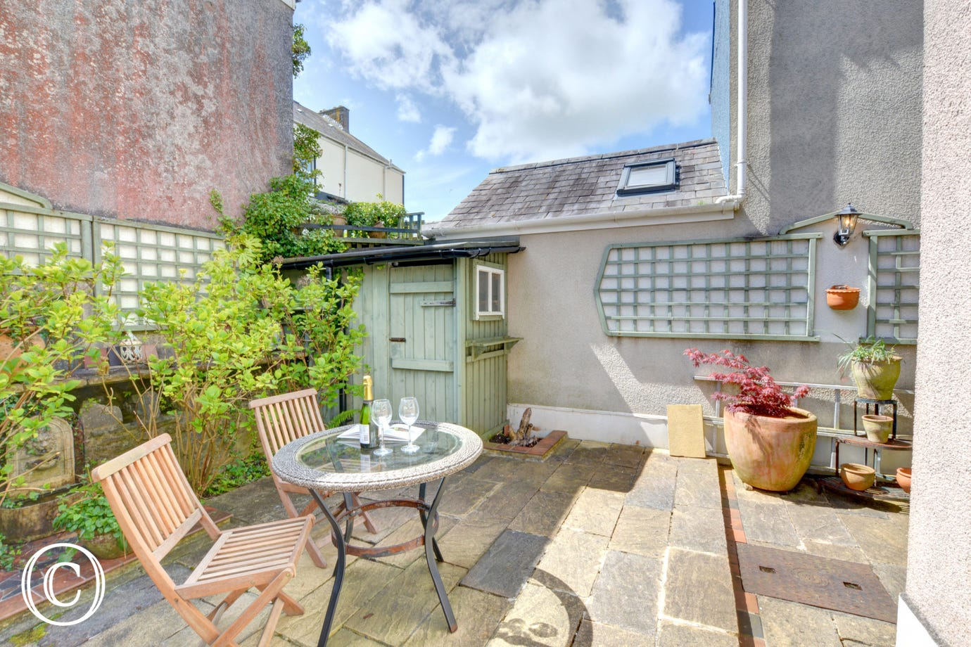 Outdoor space at this Tenby Cottage, with terrace with table & chairs