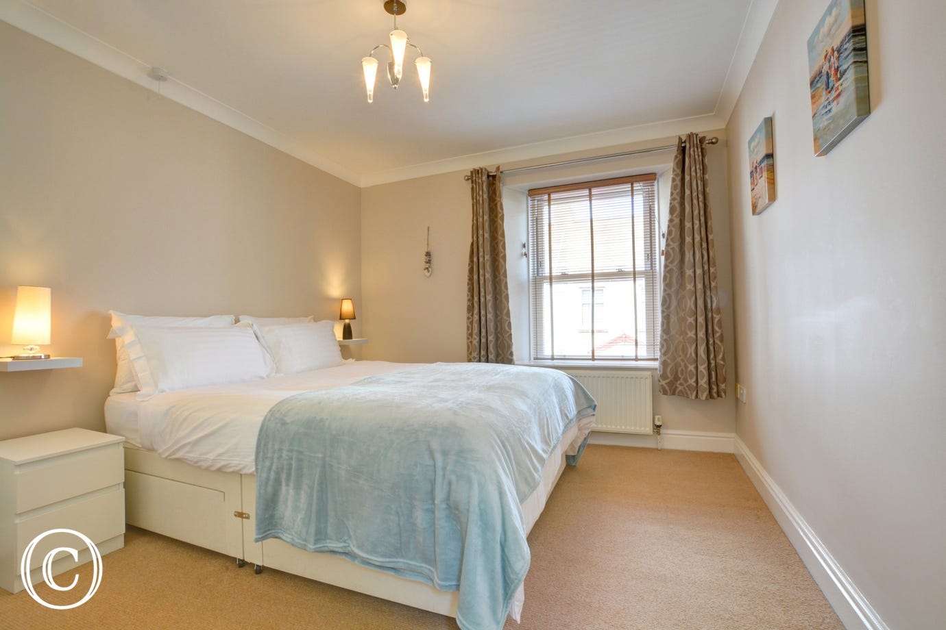 Double bed in a spacious bedroom