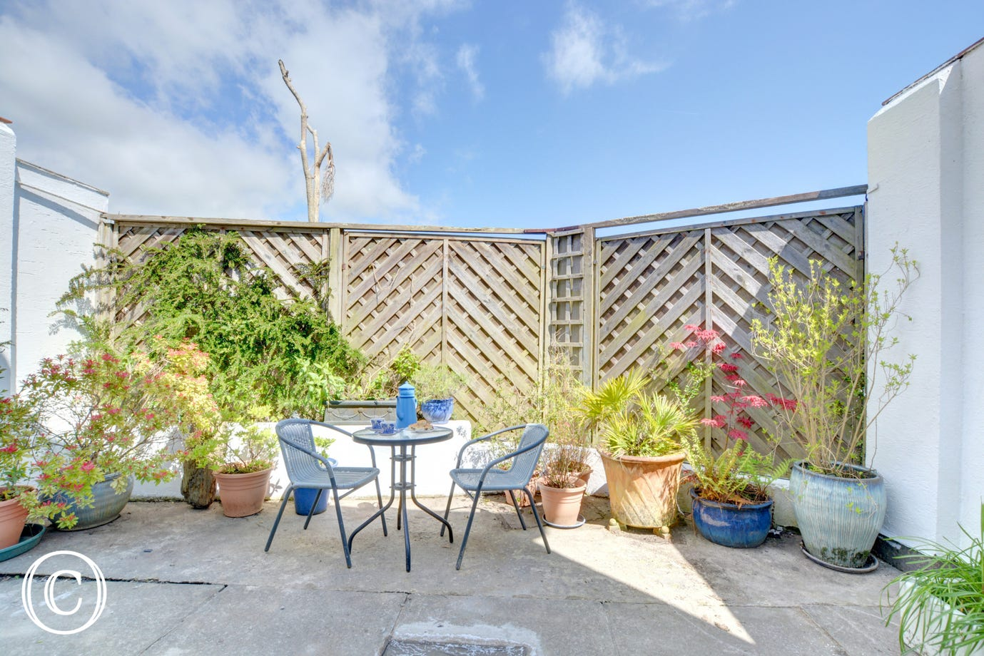A lovely patio area, accessed from the double bedroom with patio furniture.