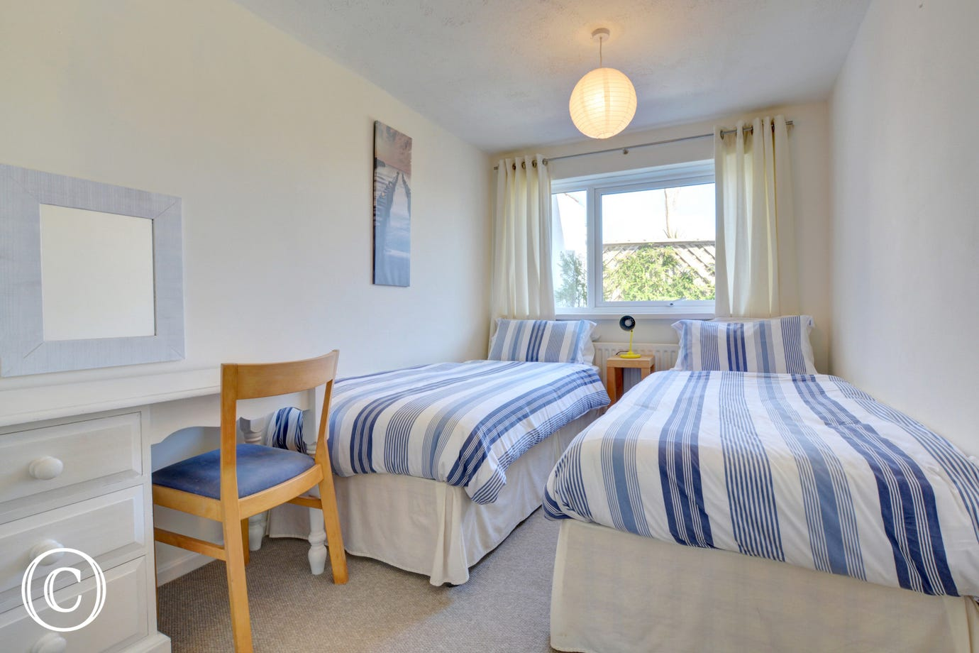 A twin bedroom at this Saundersfoot holiday home