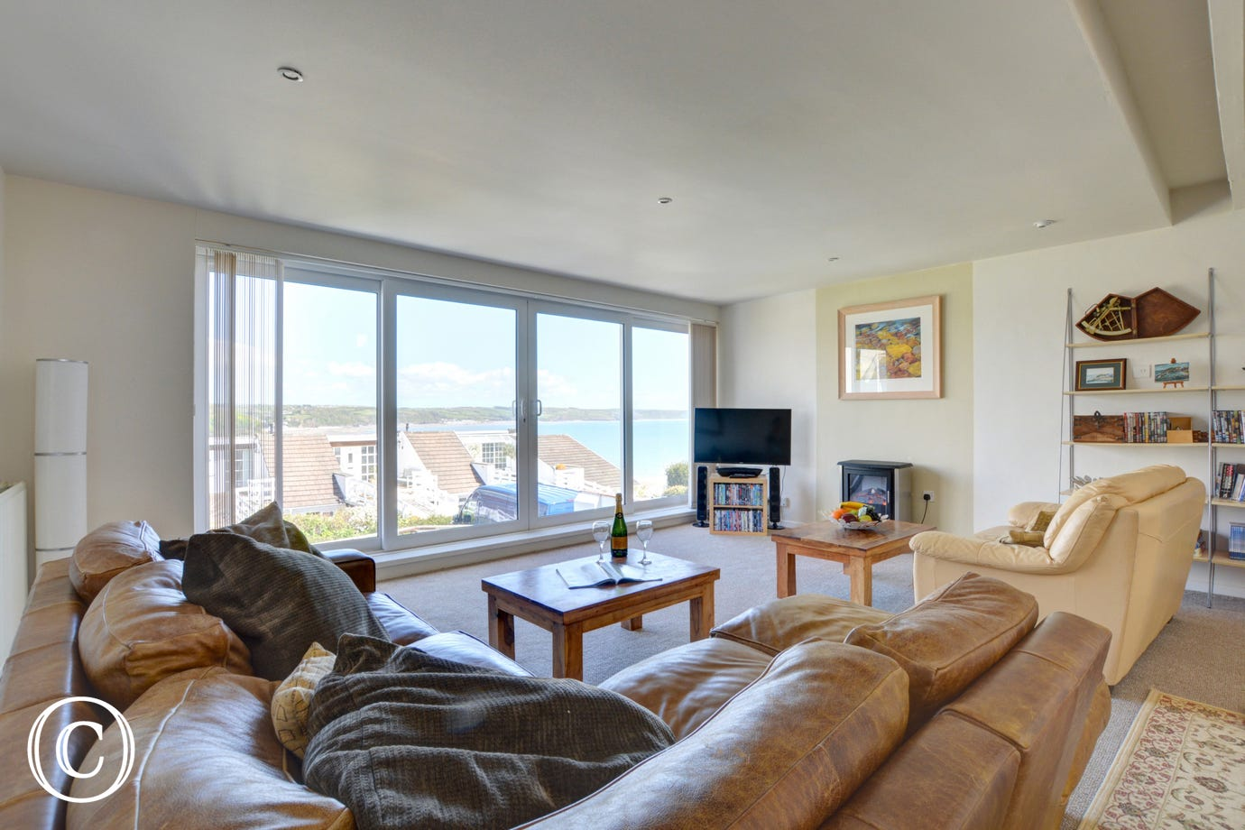 This is an alternate view of the lounge with windows looking out over the village of Saundersfoot