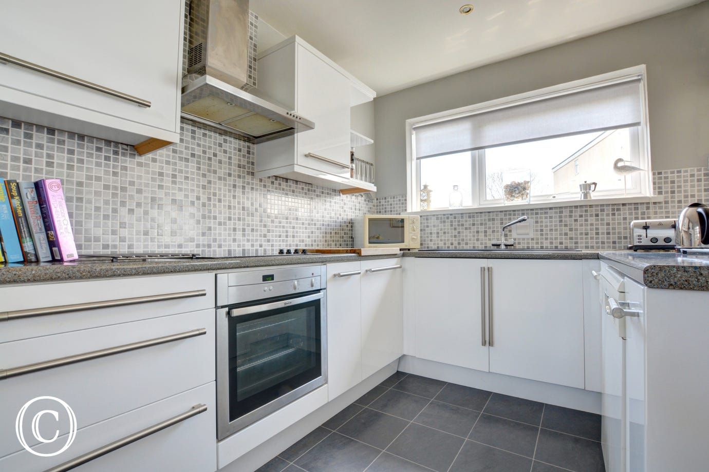 This self catering property has well equipped kitchen with hatch to the dining area