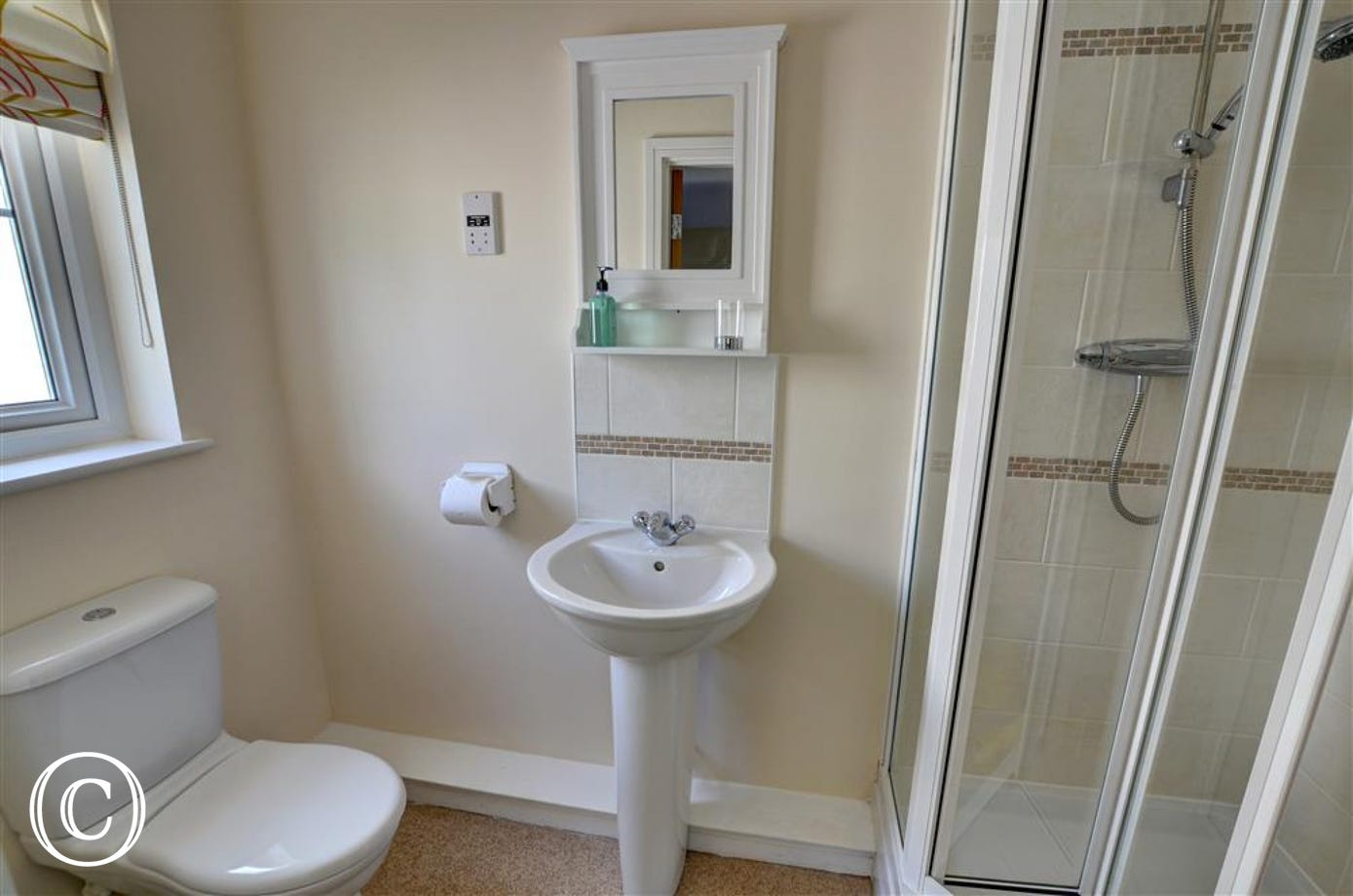 There is a smart shower room en suite to the master double bedroom