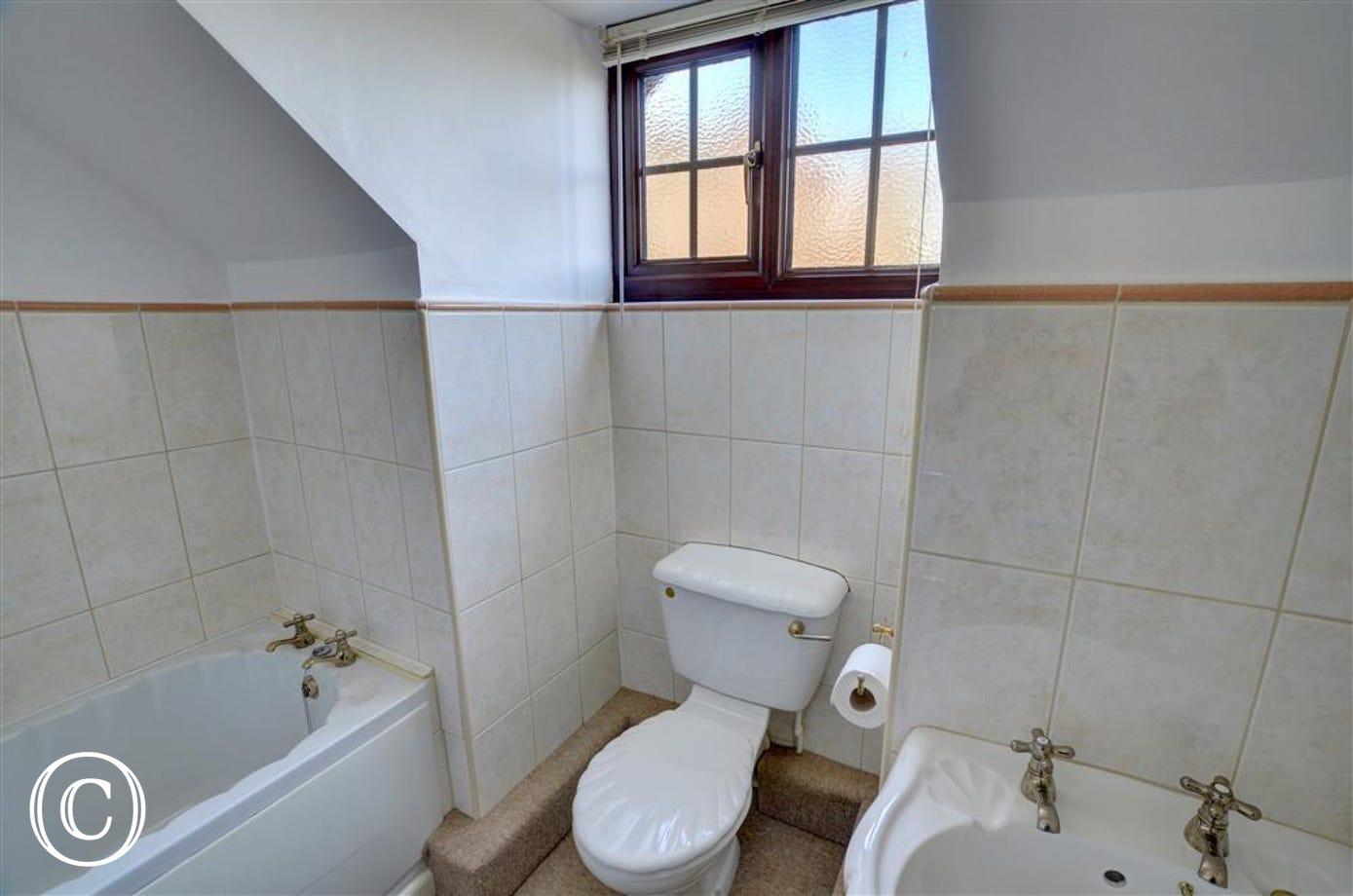 The bathroom has white fittings and is on the first floor