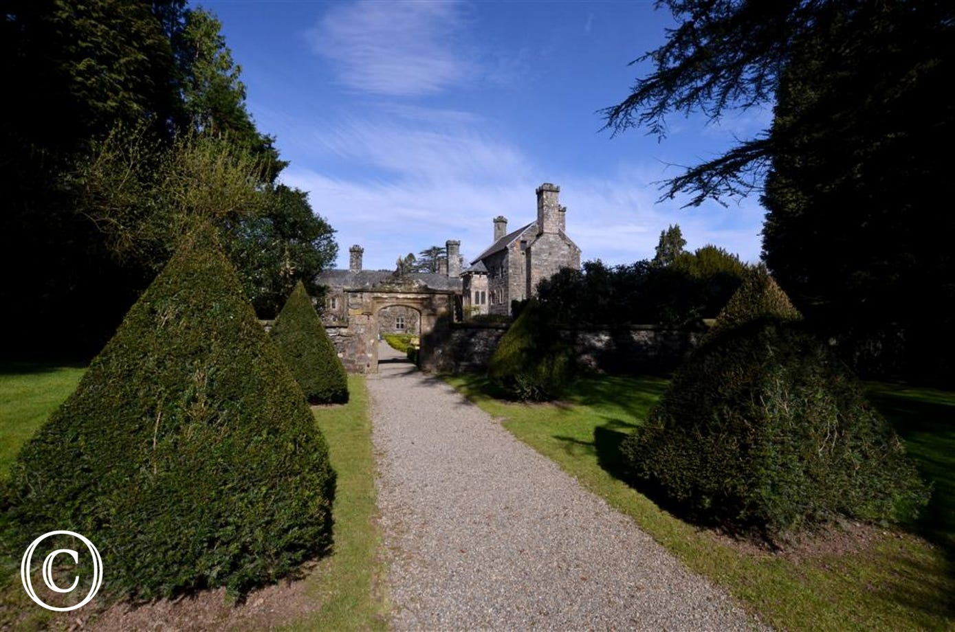 The castle is surrounded by mature landscaped gardens extending down to the river Conwy