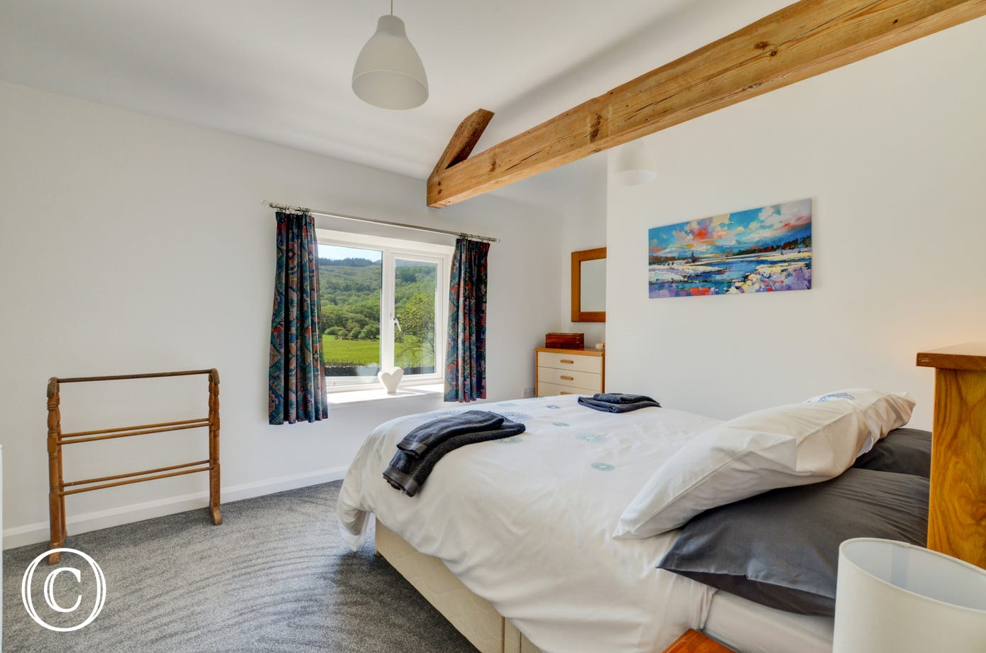 Sit up in the king size bed and take in the glorious views of the Welsh countryside