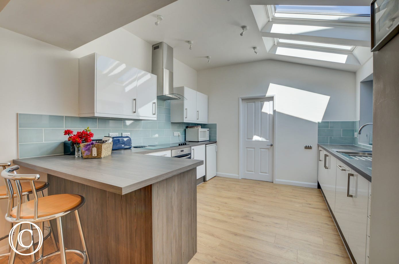 A wonderful room to cook in with modern kitchen units and skylight