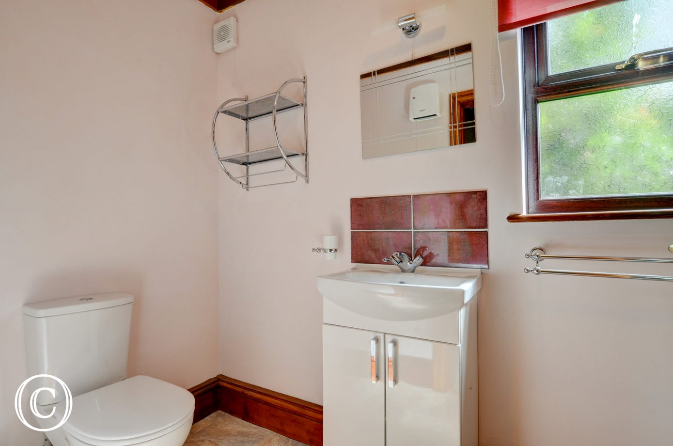 The bathroom with shower,basin and WC