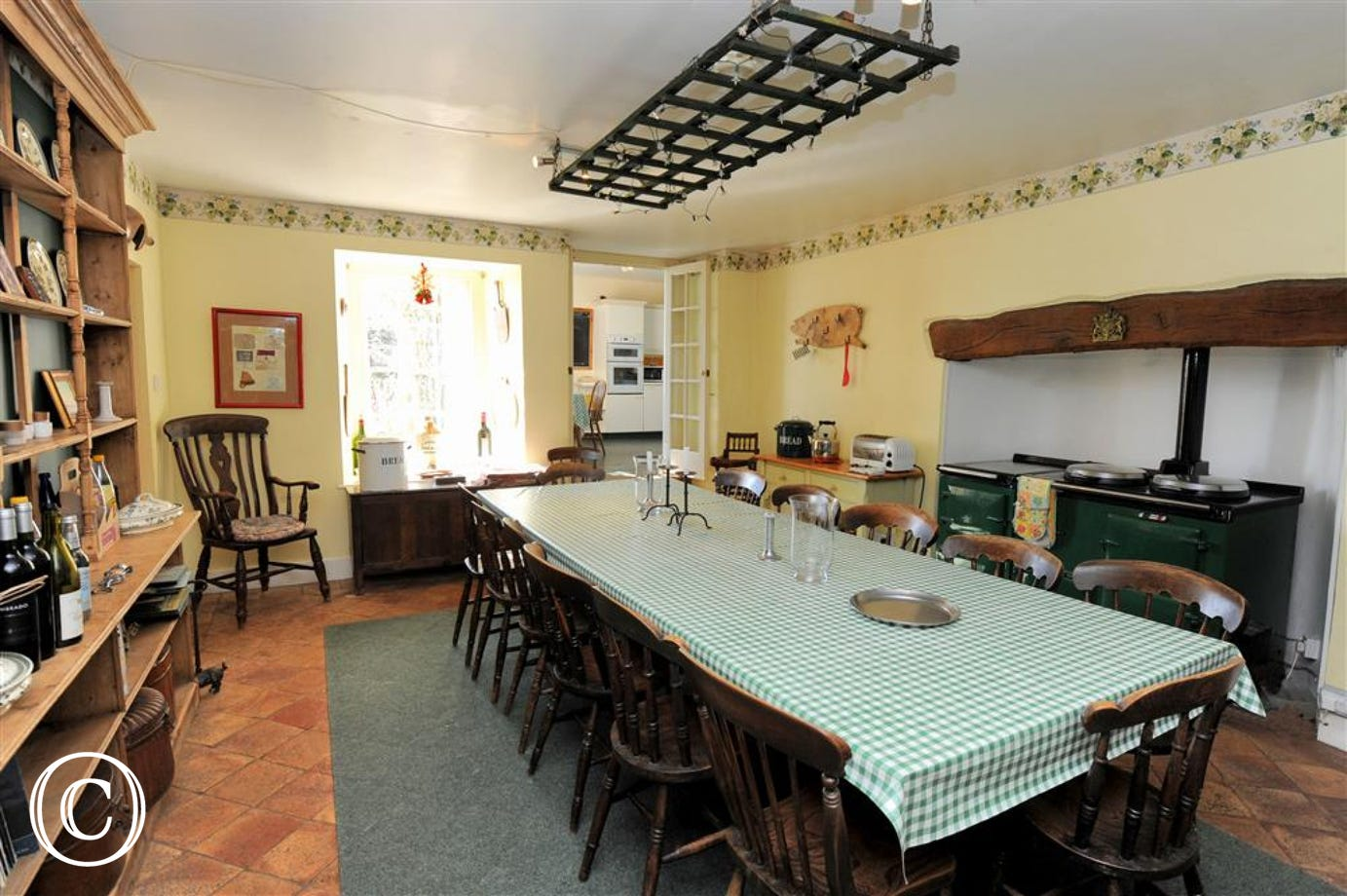 Large table & chairs easily accommodating all the family to discuss the days events.