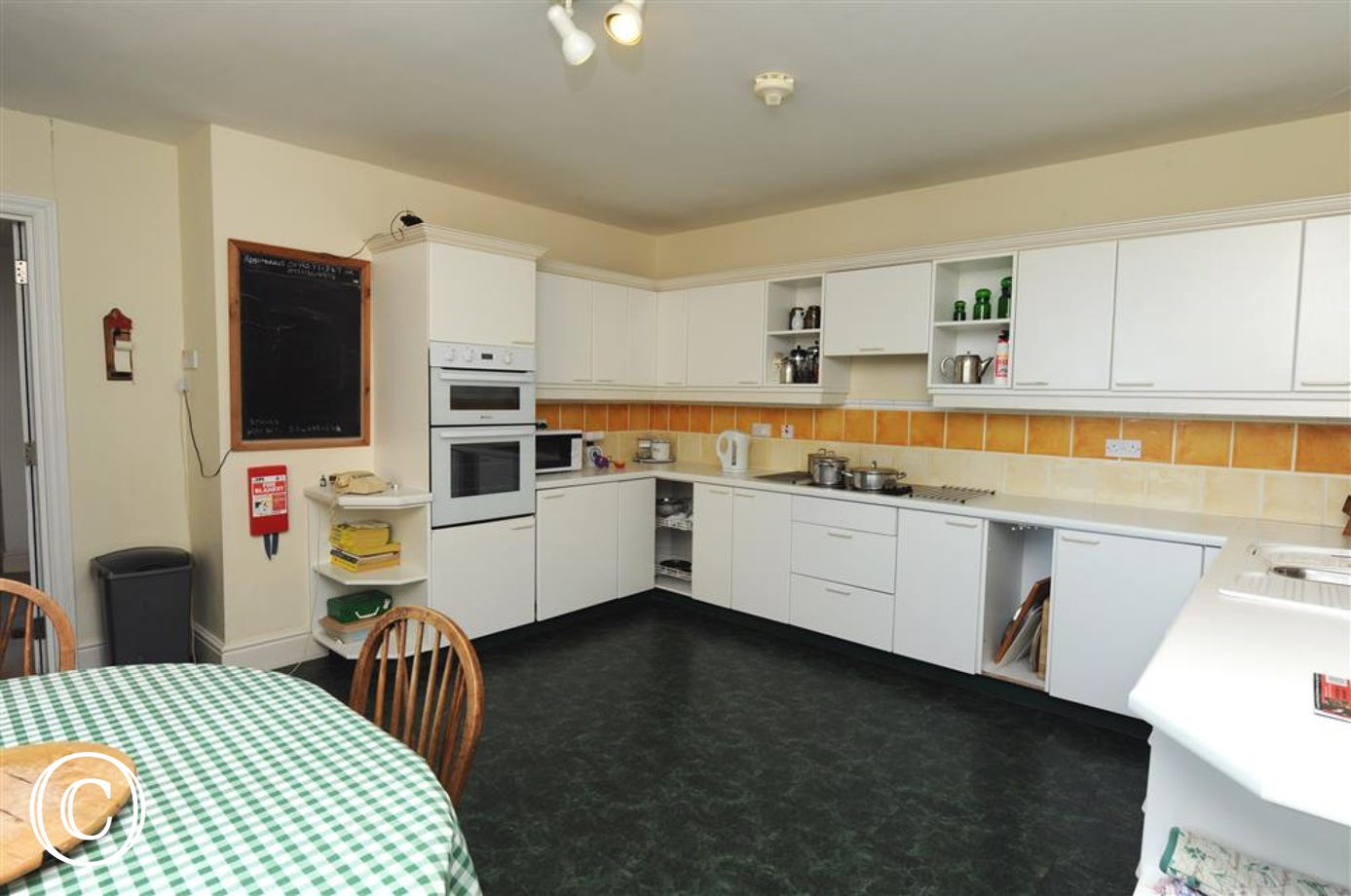 Modern Kitchen with microwave, fan oven, hob, dishwasher, fridge & fully fitted units.