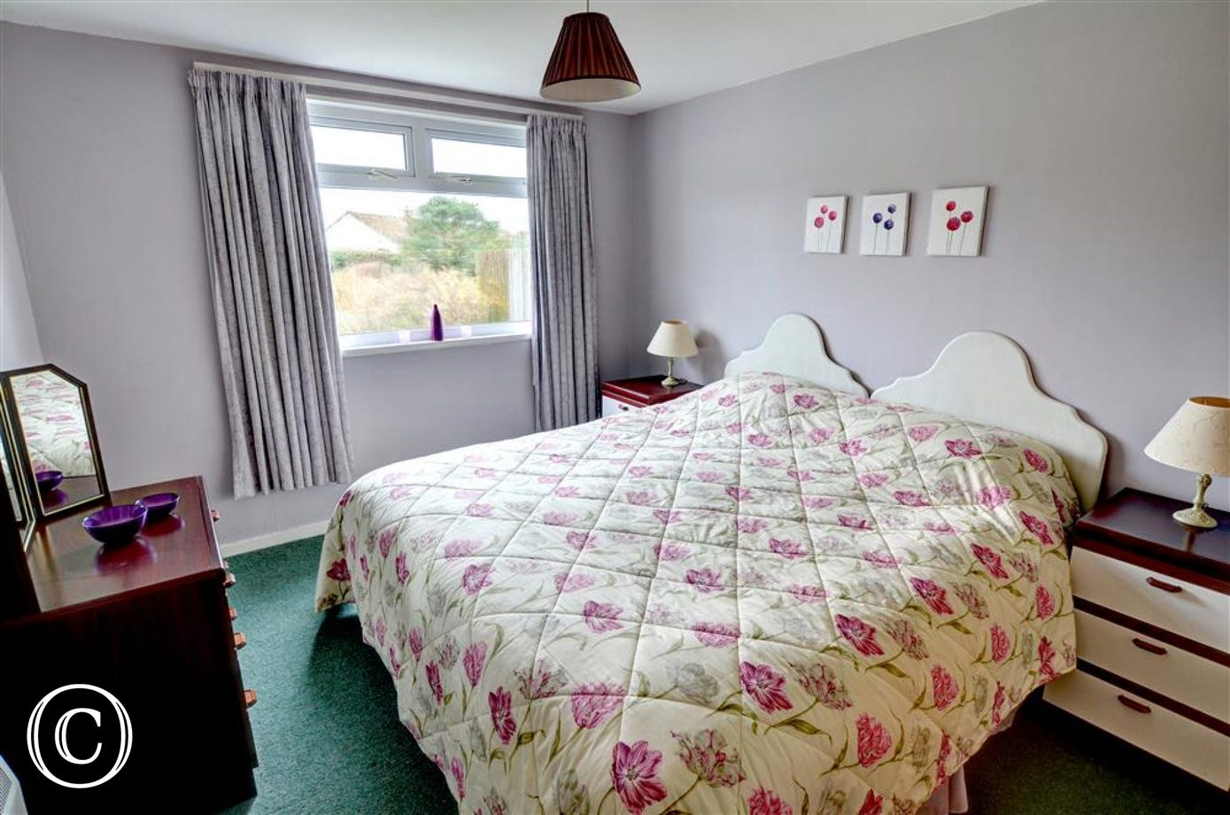 The master bedroom can be made up as super king size or twin beds