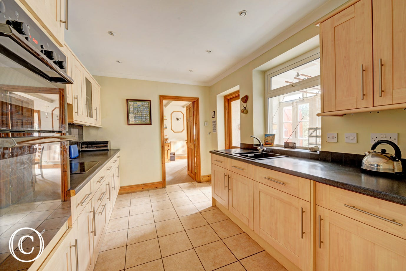 Newly fitted kitchen, with back door to sunny enclosed garden.