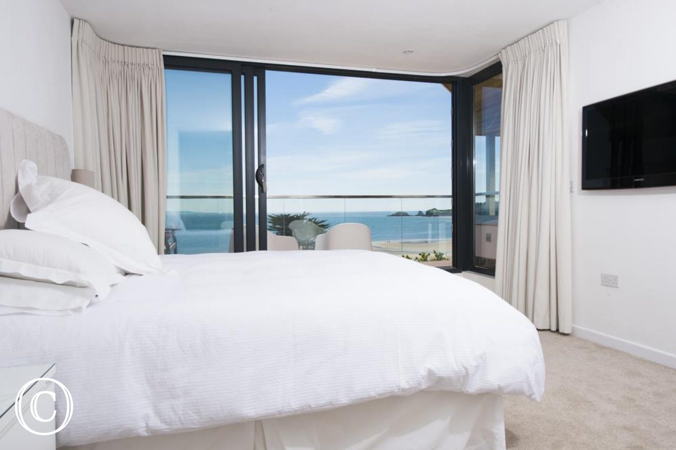 Master suite with splendid coastal views and large balcony