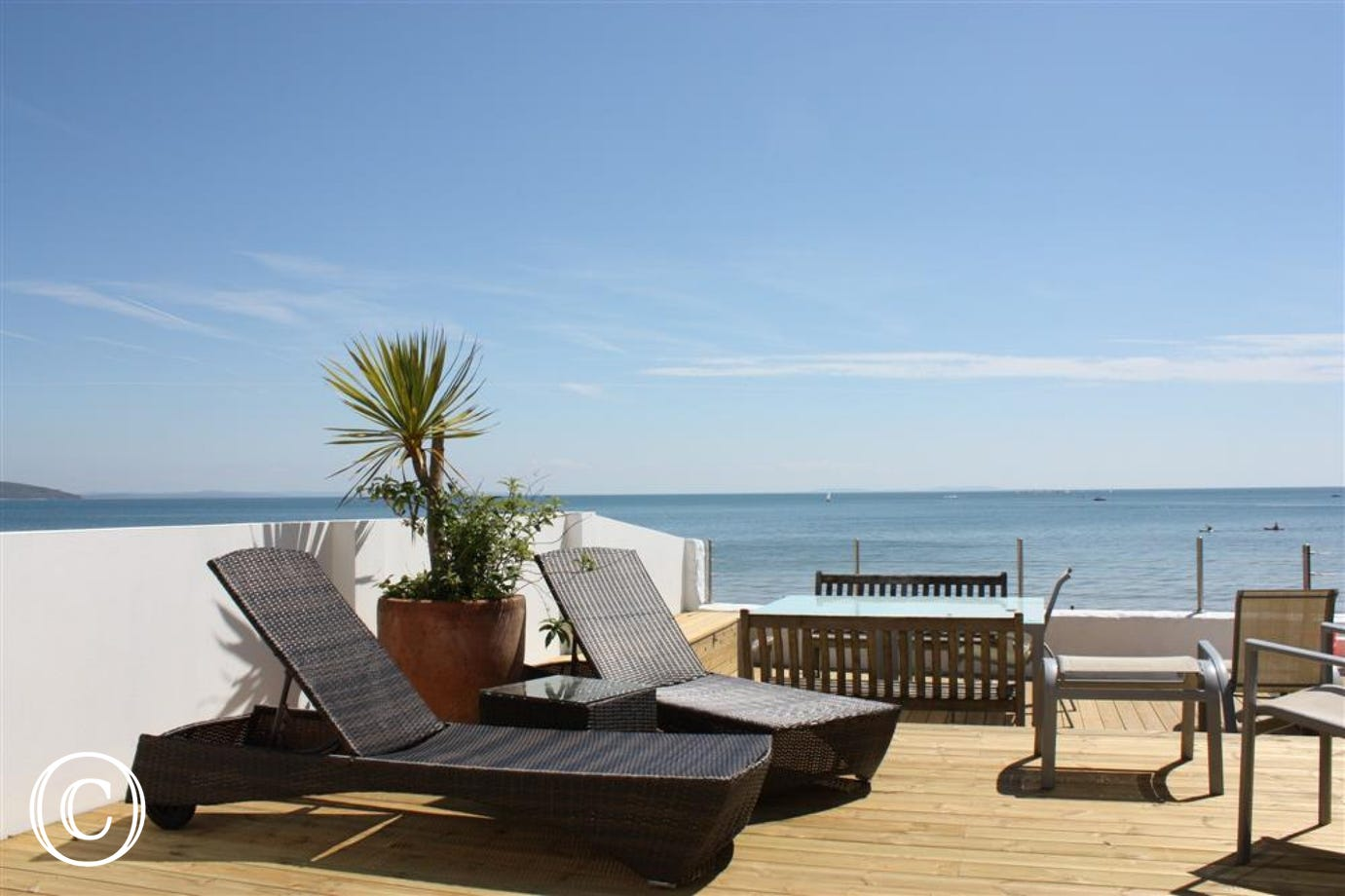 An idyllic setting in which to sit, relax and look out onto seafront.