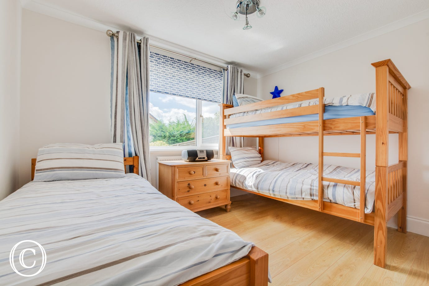 An ideal bedroom for the children with a set of bunk beds and a separate single