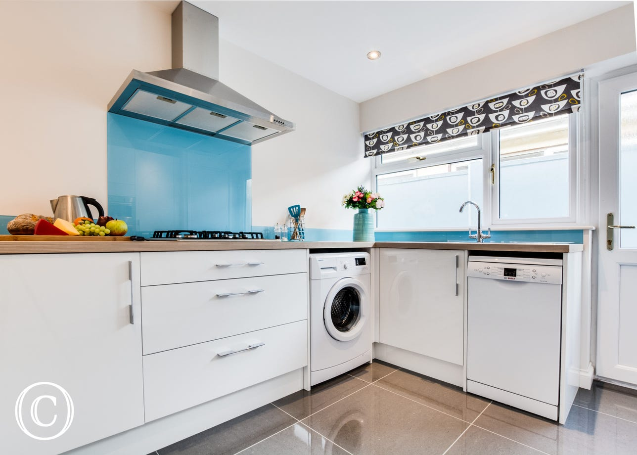 A modern and bright kitchen in this Saundersfoot holiday home