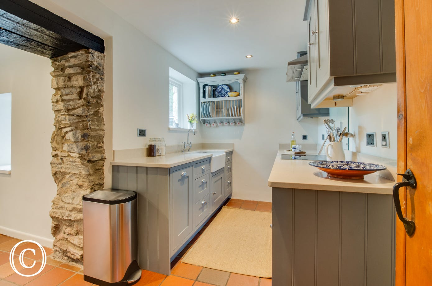 Compact kitchen with separate utility room