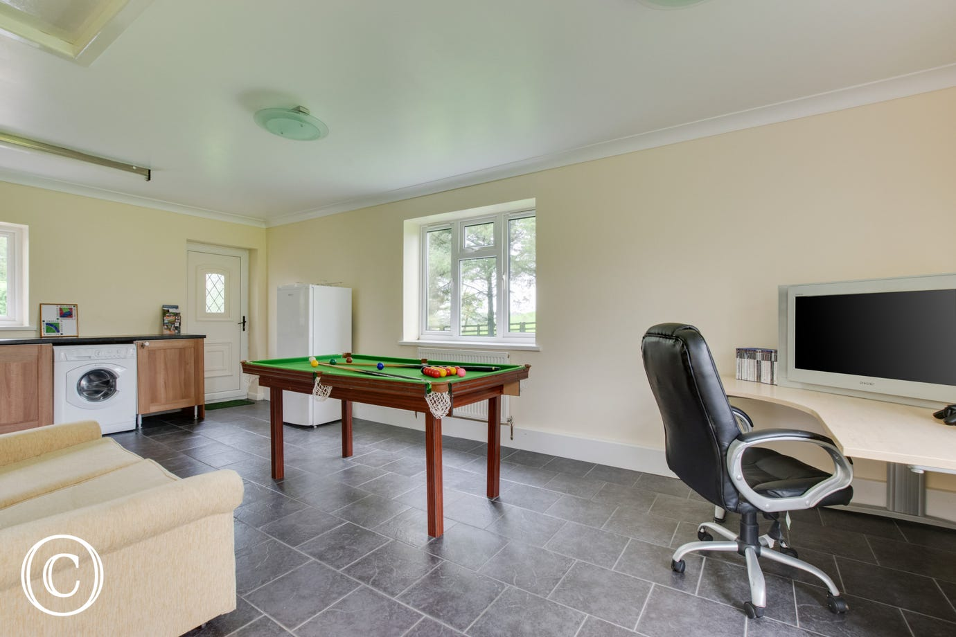 Games room with pool table and gaming area
