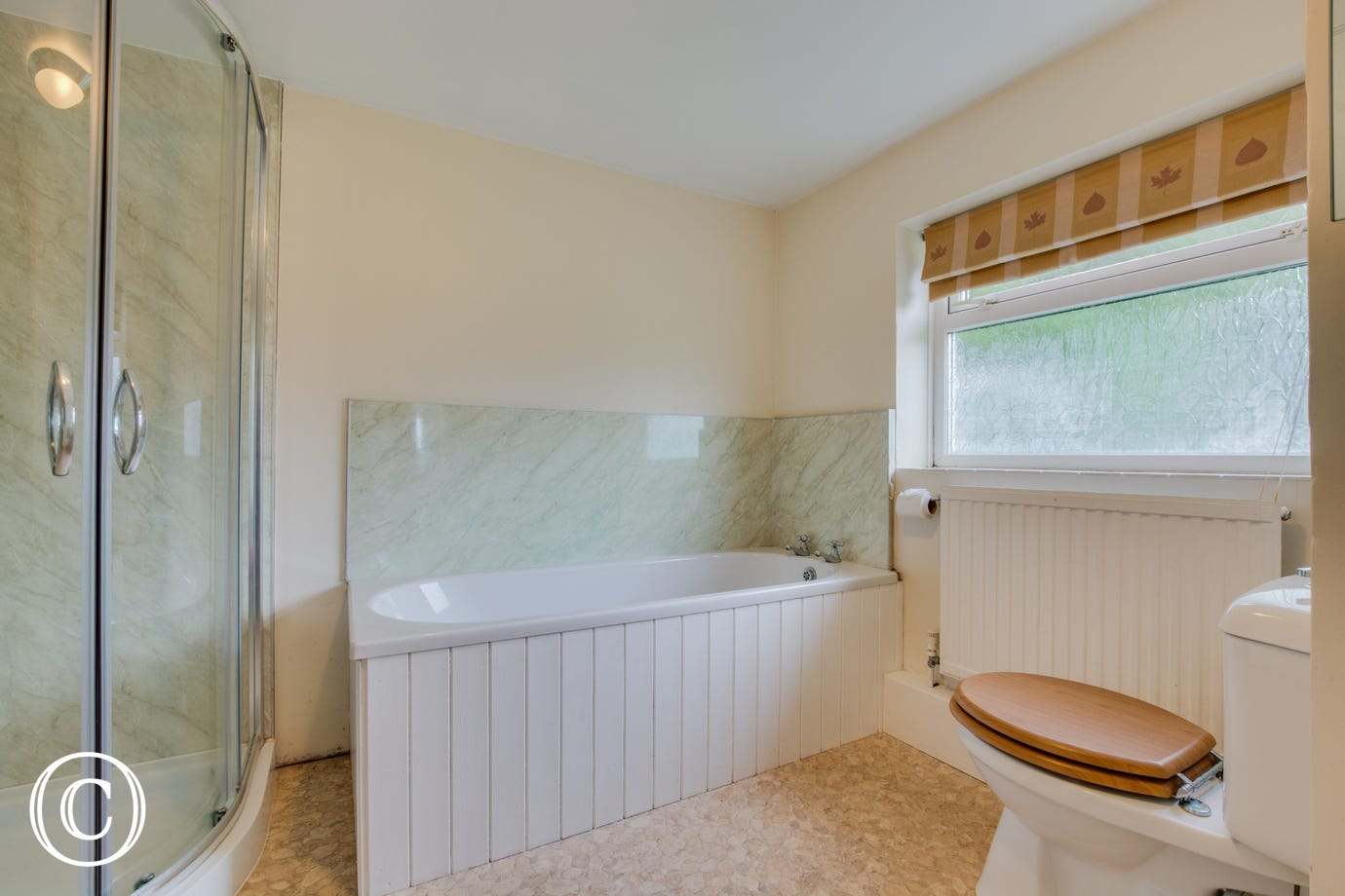 Holiday accommodation with family bathroom, bath and a separate shower cubicle.