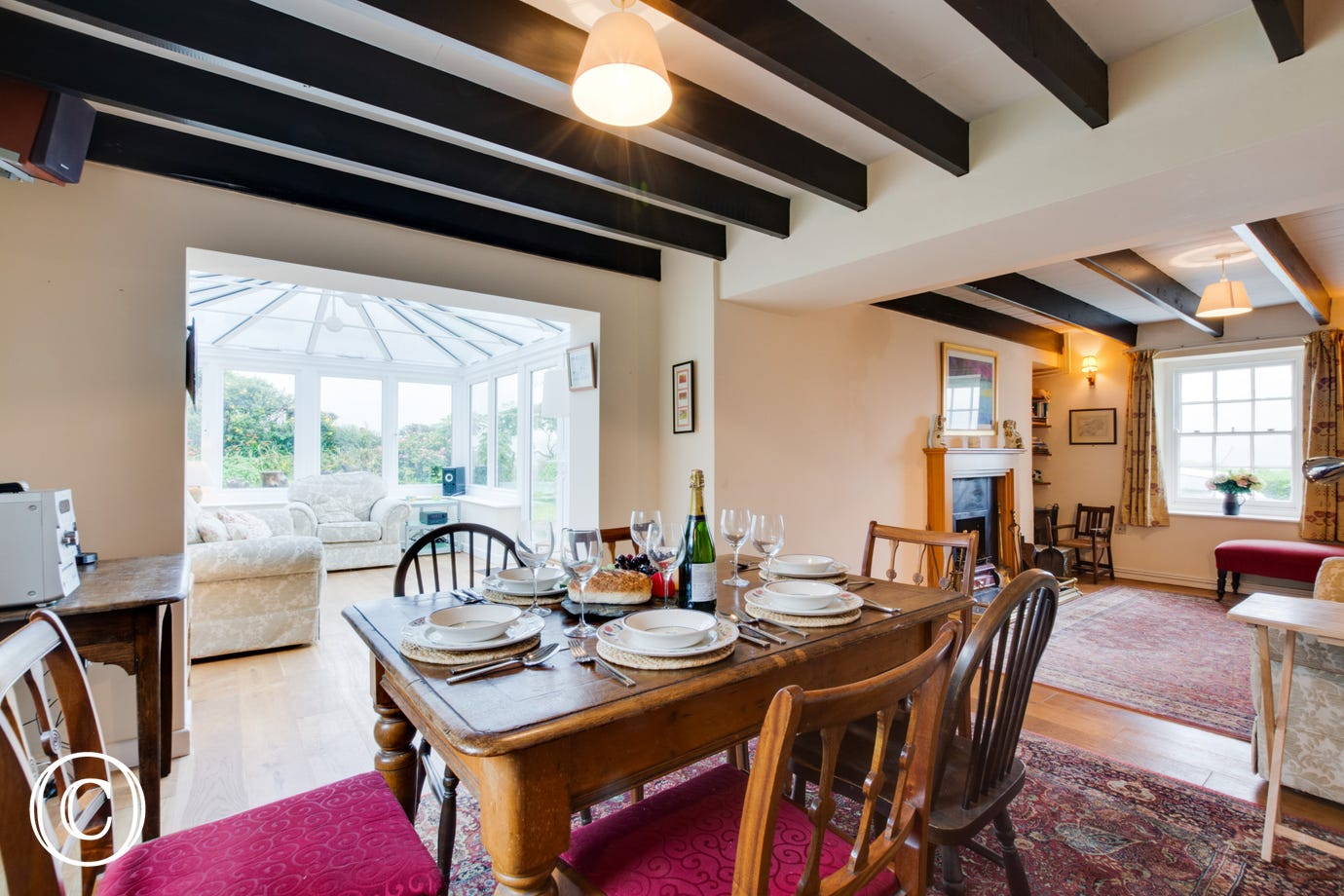 Self catering accommodation with dining room table and chairs.