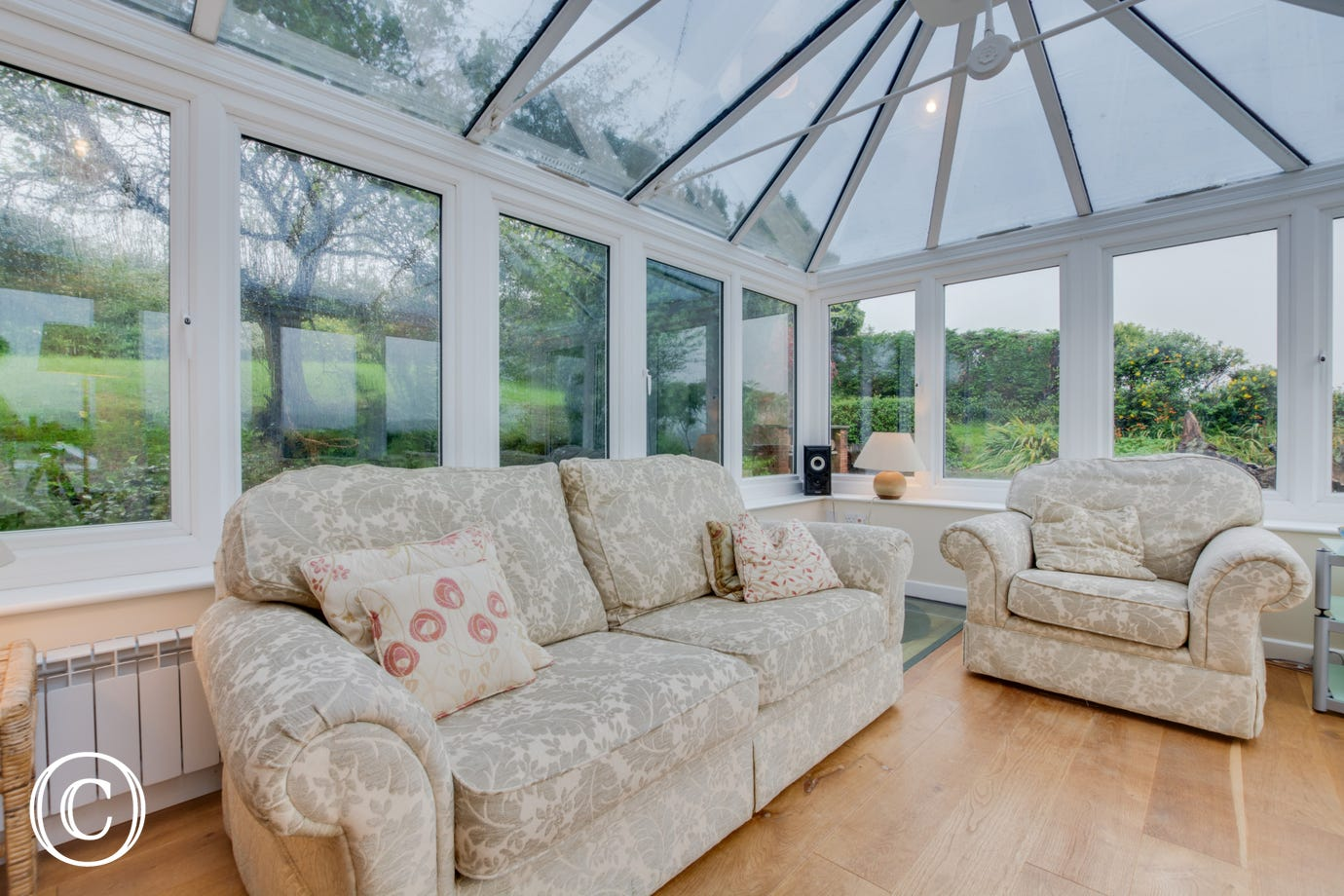 Modern conservatory to relax and enjoy the views of the garden.