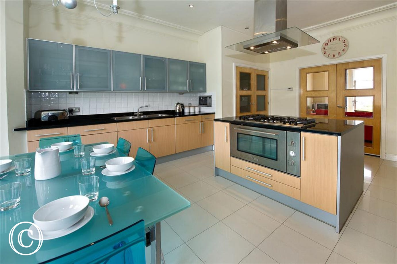 Fully renovated kitchen with modern units and an island with a 5 hob integrated cooker