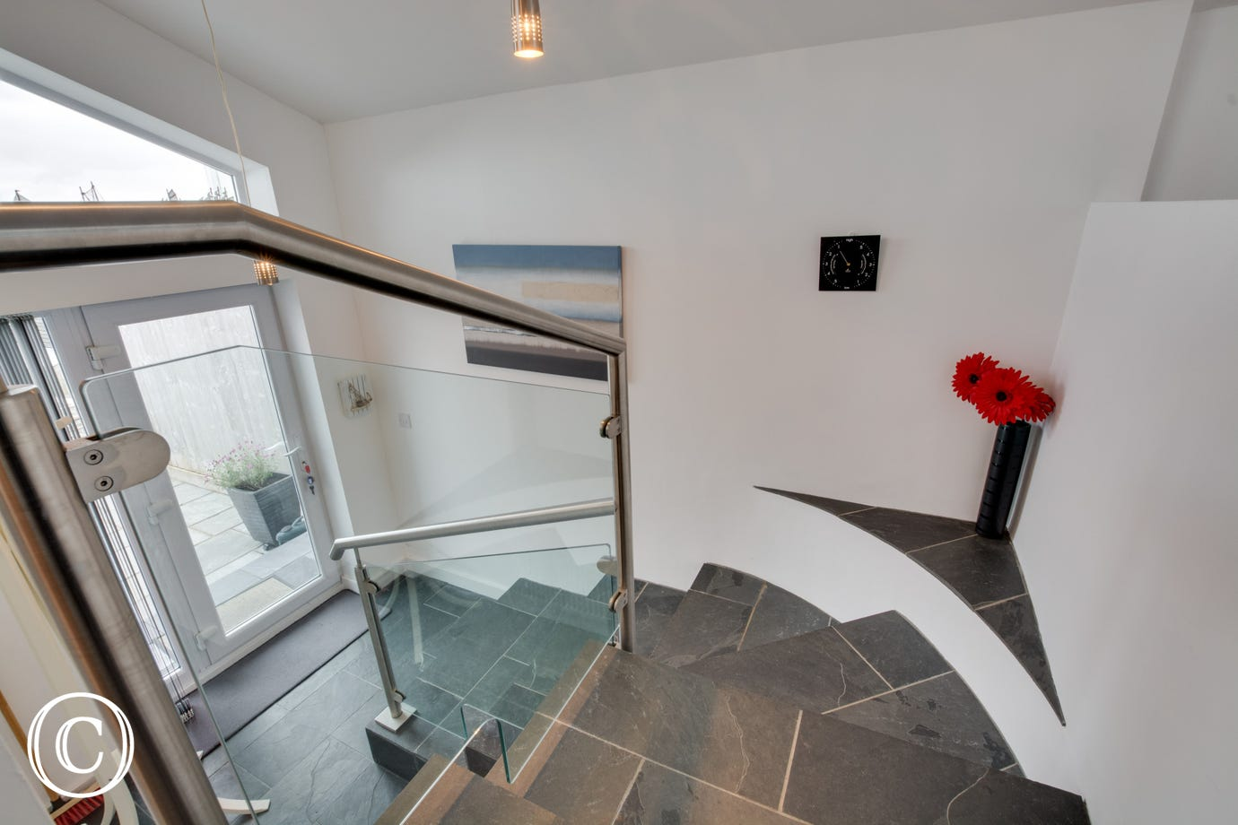 Large and open - plan bungalow with lovely sea views. Staircase